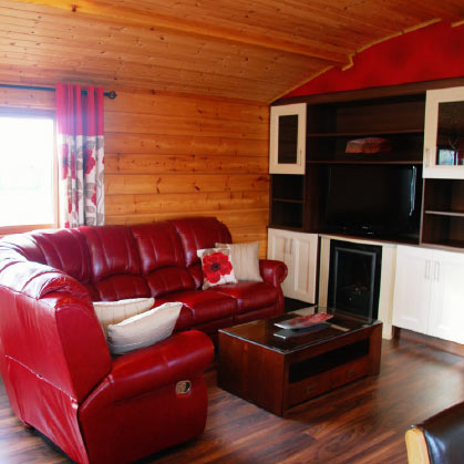 sir rogers log cabins banna beach living area